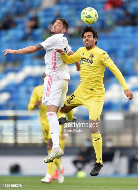 Federico Valverde of Real Madrid battles for a header with Dani Parejo of Villarreal CF during the La Liga Santander match between Real Madrid and...