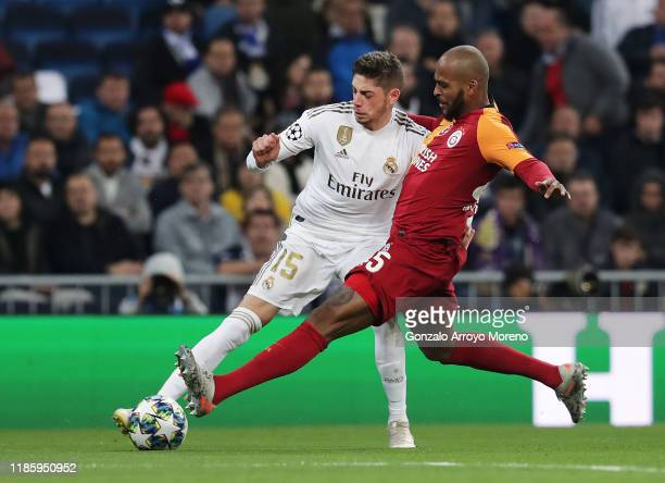Federico Valverde of Real Madrid battles for possession with Marcao of Galatasaray during the UEFA Champions League group A match between Real Madrid...