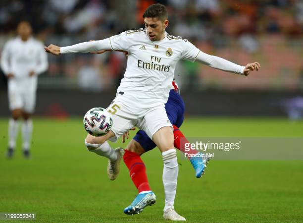 Federico Valverde of Real Madrid battles for possession with Renan Lodi of Atletico Madrid during the Supercopa de Espana Final match between Real...
