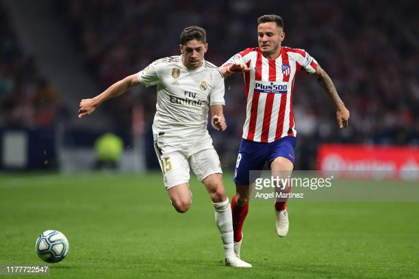 Federico Valverde of Real Madrid battles for the ball with Saul of Atletico Madrid during the Liga match between Club Atletico de Madrid and Real...
