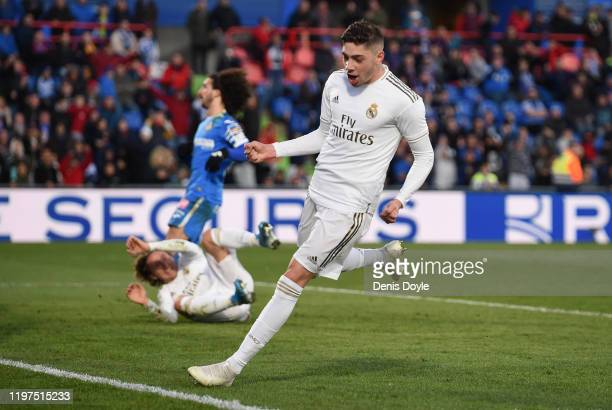 Federico Valverde of Real Madrid celebrates after teammate Luka Modric scored his team's third goal during the La Liga match between Getafe CF and...