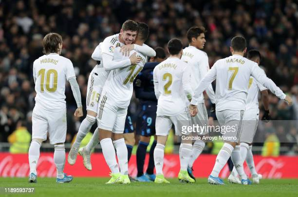 Federico Valverde of Real Madrid celebrates with teammates Casemiro and Luka Modric after scoring his team's second goal during the La Liga match...
