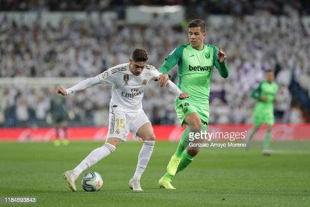 Federico Valverde of Real Madrid CF competes for the ball with Christian Rivera of Deportivo Leganes during the Liga match between Real Madrid CF and...