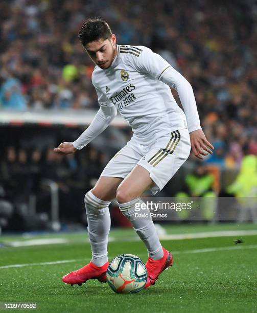 Federico Valverde of Real Madrid CF runs with the ball during the Liga match between Real Madrid CF and FC Barcelona at Estadio Santiago Bernabeu on...
