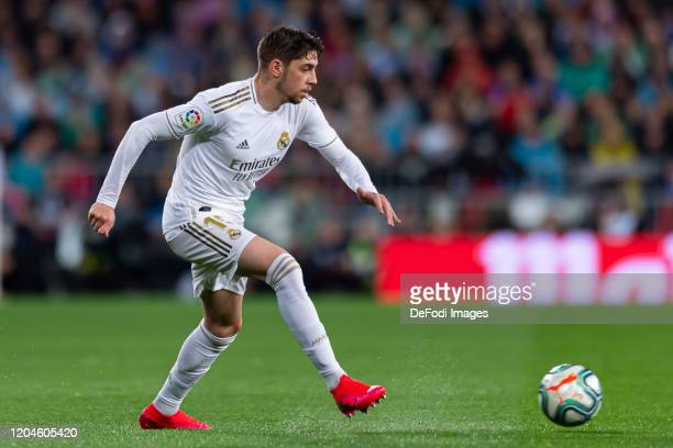Federico Valverde of Real Madrid controls the ball during the Liga match between Real Madrid CF and FC Barcelona at Estadio Santiago Bernabeu on...