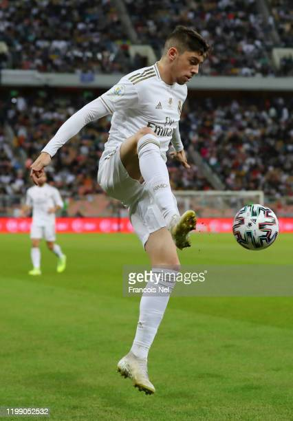 Federico Valverde of Real Madrid controls the ball in the air during the Supercopa de Espana Final match between Real Madrid and Club Atletico de...