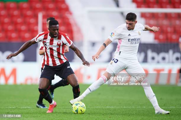 Federico Valverde of Real Madrid duels for the ball with Inaki Williams of Athletic Club during the La Liga Santander match between Athletic Club and...