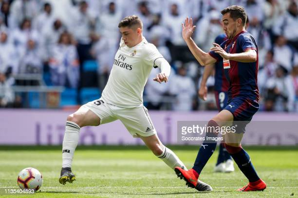 Federico Valverde of Real Madrid Gonzalo Escalante of SD Eibar during the La Liga Santander match between Real Madrid v Eibar at the Santiago...