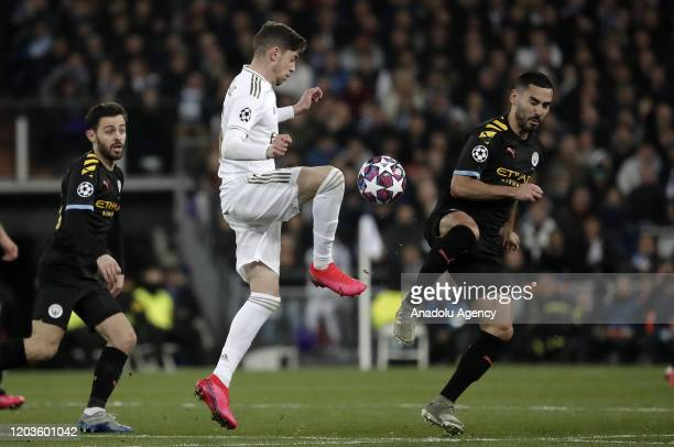 Federico Valverde of Real Madrid in action against Ilkay Gundogan of Manchester City during the UEFA Champions League round of 16 first leg soccer...