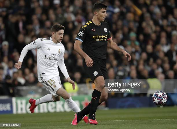 Federico Valverde of Real Madrid in action against Rodri of Manchester City during the UEFA Champions League round of 16 first leg soccer match...