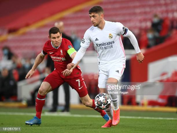 Federico Valverde of Real Madrid is challenged by James Milner of Liverpool during the UEFA Champions League Quarter Final Second Leg match between...