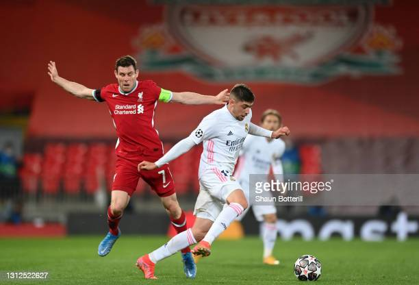 Federico Valverde of Real Madrid is closed down by James Milner of Liverpool during the UEFA Champions League Quarter Final Second Leg match between...
