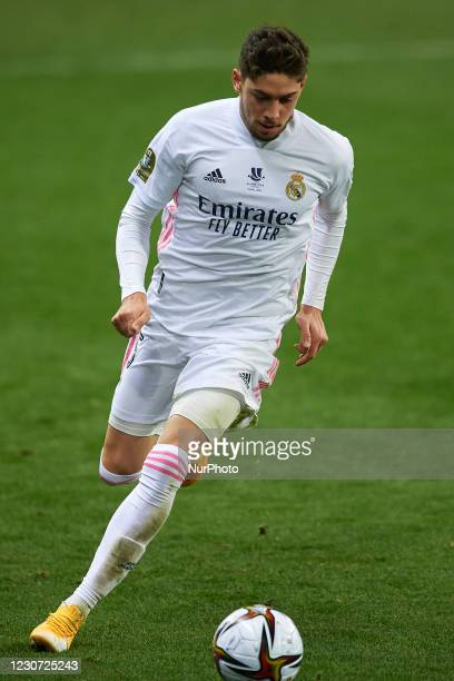 Federico Valverde of Real Madrid runs with the ball during the Supercopa de Espana Semi Final match between Real Madrid and Athletic Club at Estadio...