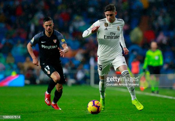Federico Valverde of Real Madrid runs with the ball during the La Liga match between Real Madrid CF and Sevilla FC at Estadio Santiago Bernabeu on...