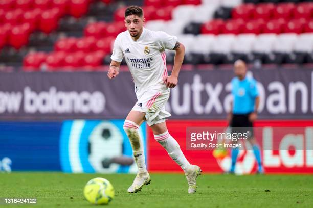 Federico Valverde of Real Madrid runs with the ball during the La Liga Santander match between Athletic Club and Real Madrid at Estadio de San Mames...