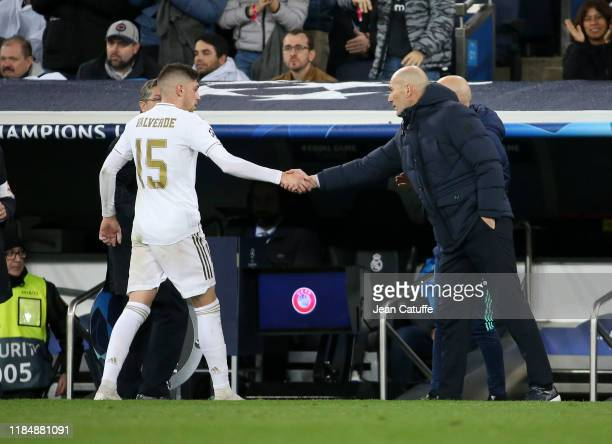 Federico Valverde of Real Madrid salutes coach of Real Madrid Zinedine Zidane when he's replaced during the UEFA Champions League group A match...