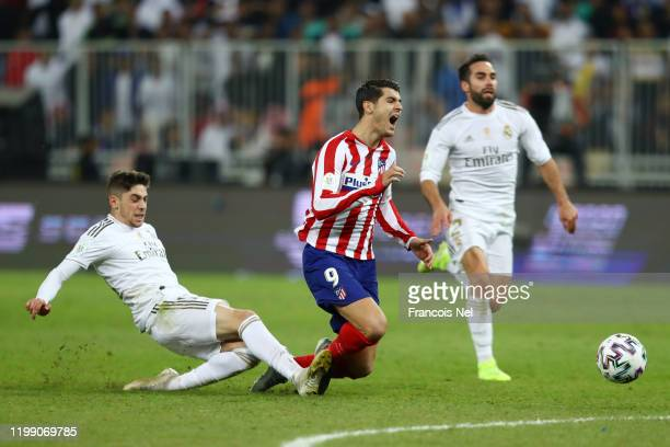 Federico Valverde of Real Madrid tackles Alvaro Morata of Atletico Madrid which results in the red card being shown to Federico Valverde of Real...