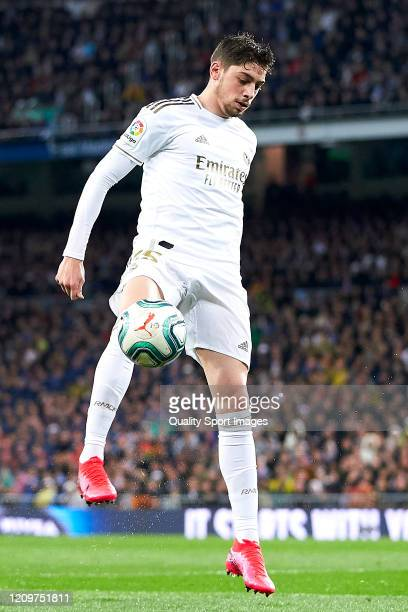 Federico Valverde of Real Madrid with the ball during the Liga match between Real Madrid CF and FC Barcelona at Estadio Santiago Bernabeu on March 01...