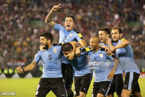 Federico Valverde of Uruguay celebrates with teammates Luis Suarez José María Gimenez Carlos Sanchez Matias Vecino and Christian Stuani after scoring...