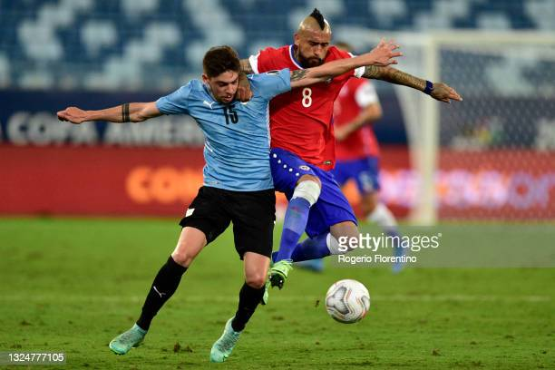 Federico Valverde of Uruguay competes for the ball with Arturo Vidal of Chile during a group A match between Uruguay and Chile as part of Conmebol...
