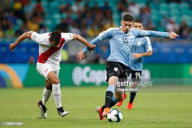Federico Valverde of Uruguay controls the ball under pressure of Luis Abram of Peru during the Copa America Brazil 2019 quarterfinal match between...