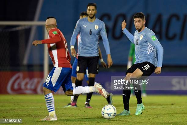 Federico Valverde of Uruguay fights for the ball with Ángel Cardozo of Paraguay during a match between Uruguay and Paraguay as part of South American...