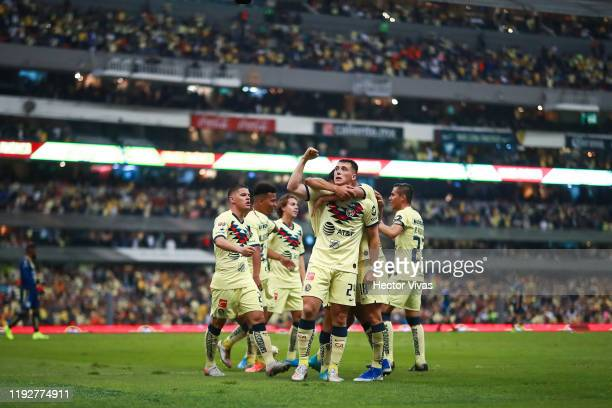 Federico Viñas of America celebrates with teammates after scoring the second goal of his team during the Semifinals second leg match between America...