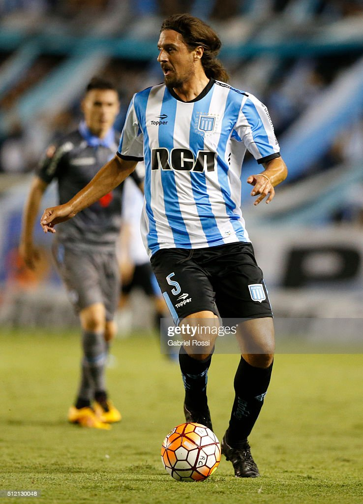 Federico Vismara of Racing Club drives the ball during a group stage match between Racing Club and Bolivar as part of Copa Bridgestone Libertadores 2016 at Presidente Peron Stadium on February 24, 2016 in Avellaneda, Argentina.