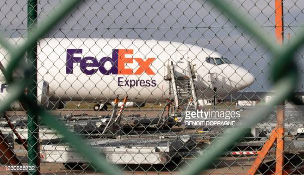 FedEx airplane is pictured at the terminal of the FedEx - TNT logistics company in Grace-Hollogne, near Liege airport, on January 20 a day after...