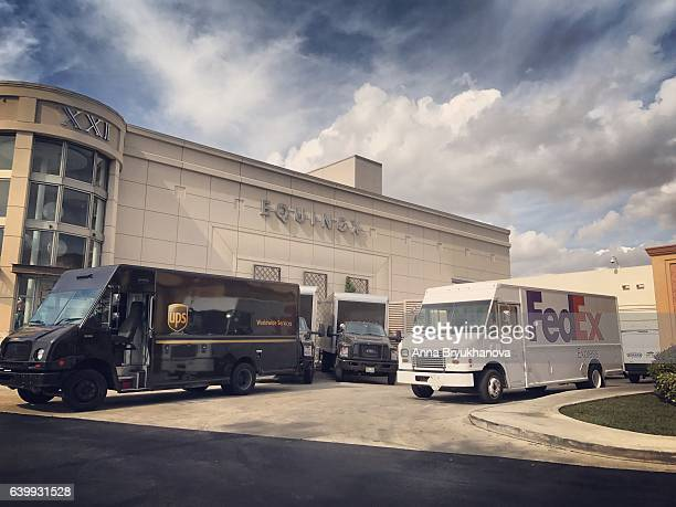 fedex and ups trucks parked near aventura shopping mall - fedex truck stock pictures, royalty-free photos & images