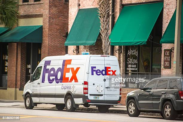 fedex car parked on tampa street, florida, usa - fedex truck stock pictures, royalty-free photos & images