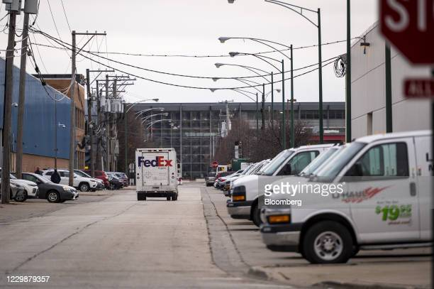 FedEx Corp. Express truck drives out from a distribution center in Chicago, Illinois, U.S., on Monday, Nov. 30, 2020. Online shoppers in the U.S. Are...