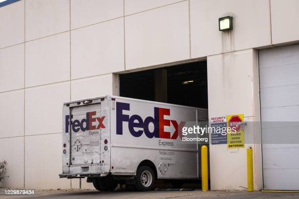 FedEx Corp. Express truck enters a distribution center in Chicago, Illinois, U.S., on Monday, Nov. 30, 2020. Online shoppers in the U.S. Are expected...