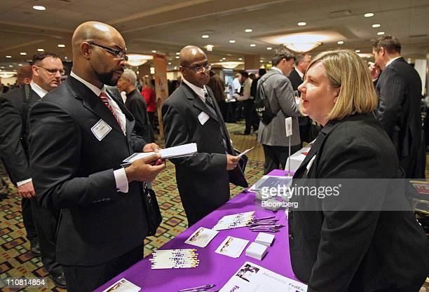 FedEx Corp representative Kari Maslowski right speaks with job seeker Kevin Allison at the Hiring Our Heroes veterans employment fair sponsored by...