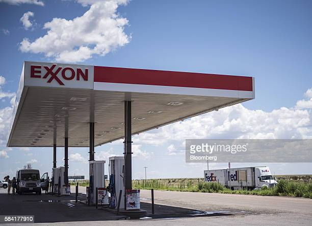 A FedEx Corp truck drives past a roadside Exxon Corp gas station outside Aurora New Mexico US on Tuesday July 26 2016 Exxon Mobil Corp is scheduled...