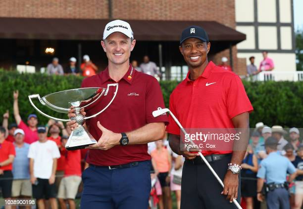 FedEx Cup Champion Justin Rose of England and TOUR Championship winner Tiger Woods of the United States pose following the final round of the TOUR...