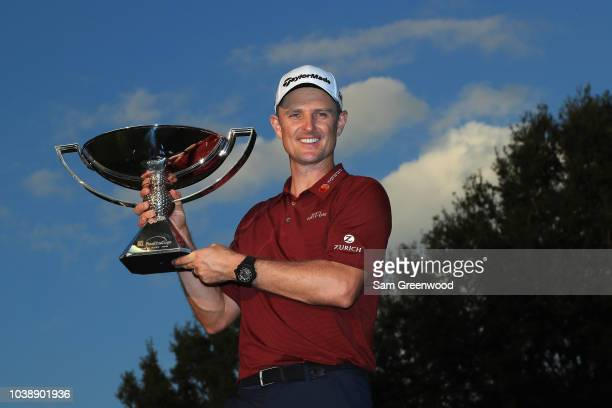 FedEx Cup Champion Justin Rose of England poses with the FedExCup trophy after the final round of the TOUR Championship at East Lake Golf Club on...
