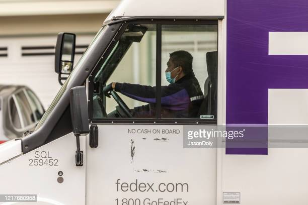 fedex driver covid19 - essential workers stock pictures, royalty-free photos & images