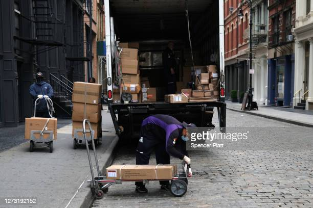 FedEx driver makes deliveries in Manhattan on September 17, 2020 in New York City. As more people purchase items online and receive home shipments,...