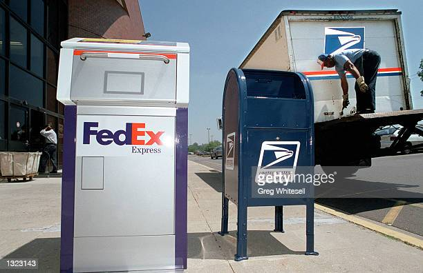 FedEx drop box sits next to a US mail box and mail truck at the announcement of FedEx and the US Postal Service''s business aggreement June 19 2001...