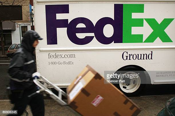 FedEx employee delivers packages March 19 2008 in New York City Following news that its profits dropped 75% in the third quarter FedEx said it plans...