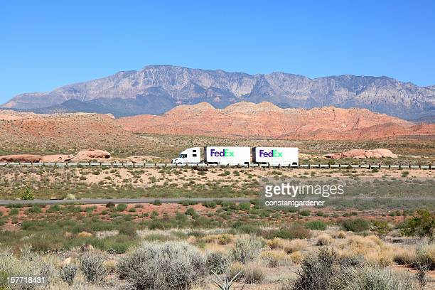 fedex ground traveling the beautiful american landscape - federal express stock pictures, royalty-free photos & images