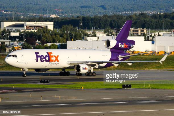 L AIRPORT ANCHORAGE ALASKA UNITED STATES FedEx seen taxiing towards its stand for refueling