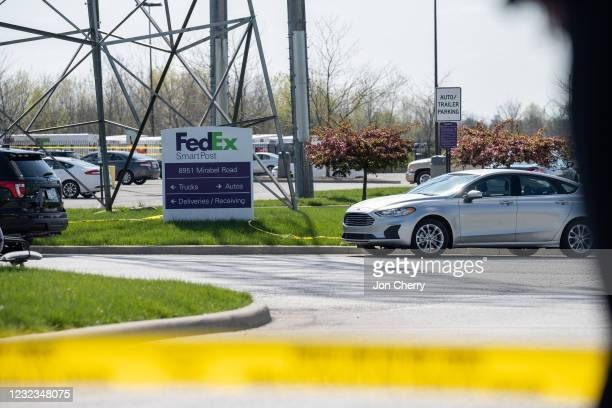 FedEx SmartPost sign is seen surrounded by crime scene tape at a FedEx Ground facility on April 16, 2021 in Indianapolis, Indiana. The area is the...