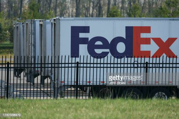 FedEx trailers are parked at the site of a mass shooting at a FedEx facility in Indianapolis, Indiana, on April 16, 2021. - At least eight people...