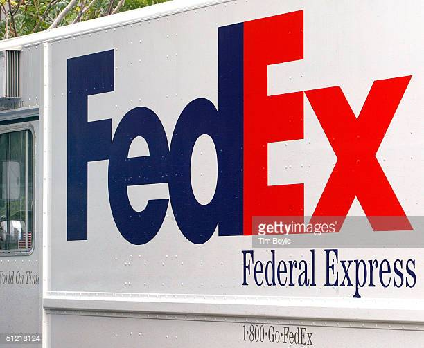 FedEx truck is parked along a street August 25 2004 in Chicago Illinois FedEx Corporation announced that it expects to report higher earnings of $100...