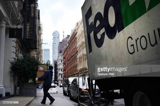FedEx truck makes deliveries in Manhattan on September 17, 2020 in New York City. As more people purchase items online and receive home shipments,...