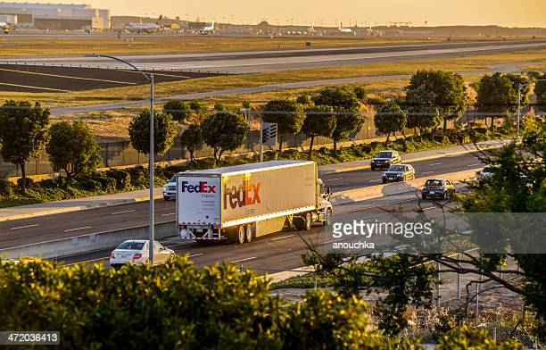 fedex truck on the road, sunset at lax - fedex truck stock pictures, royalty-free photos & images