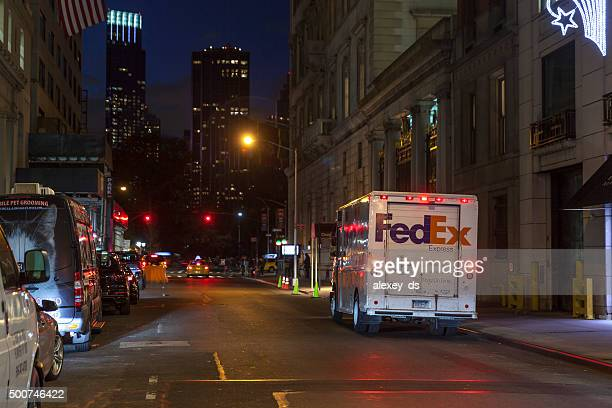 fedex van parked at night new york street - federal express stock pictures, royalty-free photos & images