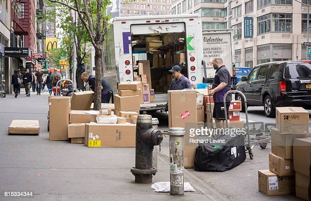 FedEx workers sort deliveries in the Chelsea neighborhood of New York on Friday May 15 2015 FedEx reported earnings for the holiday quarter which...